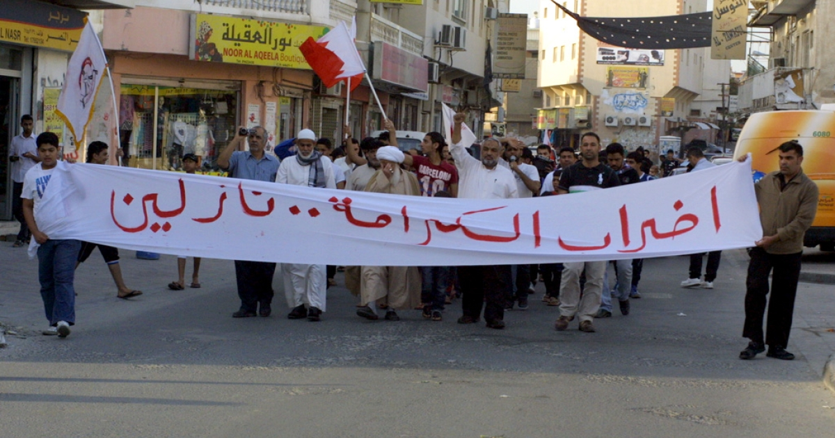 Shia demonstrators protest against discrimination and for democratic rights in Al Daih village. All demonstrations are illegal in Bahrain.</p>