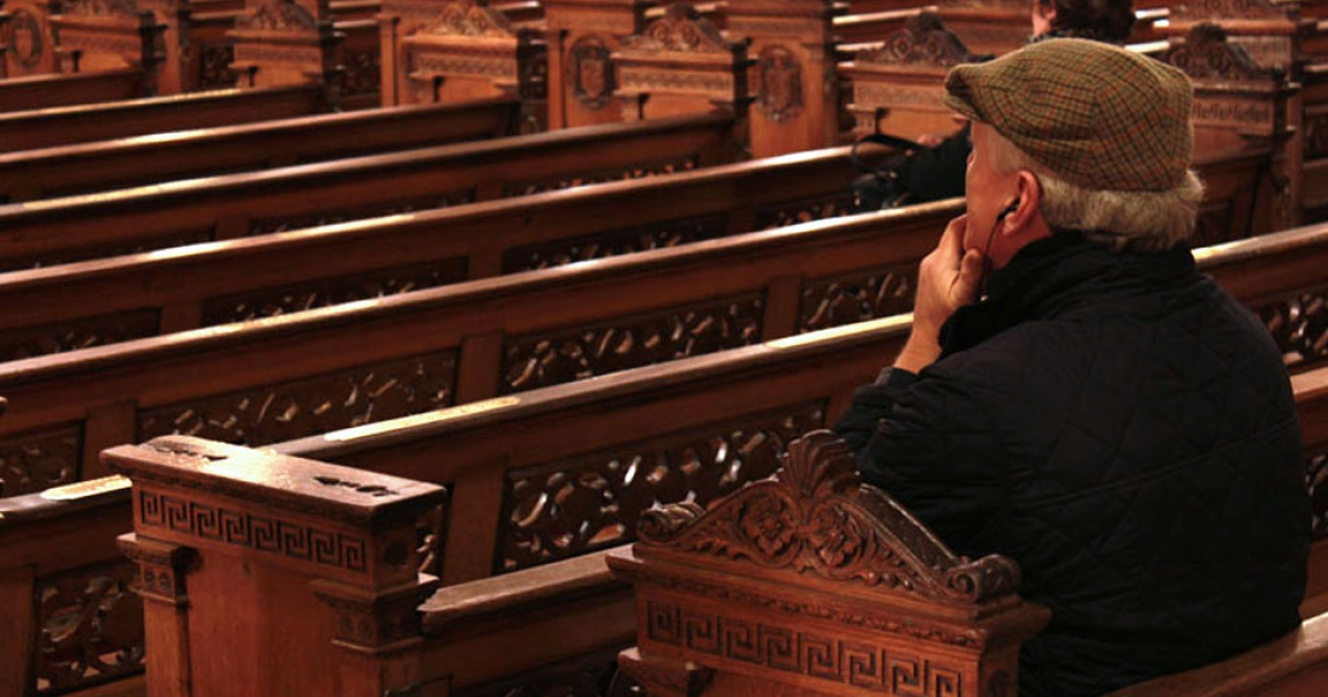 A man sits inside St. Mary's Pro-Cathedral in Dublin, Ireland.</p>