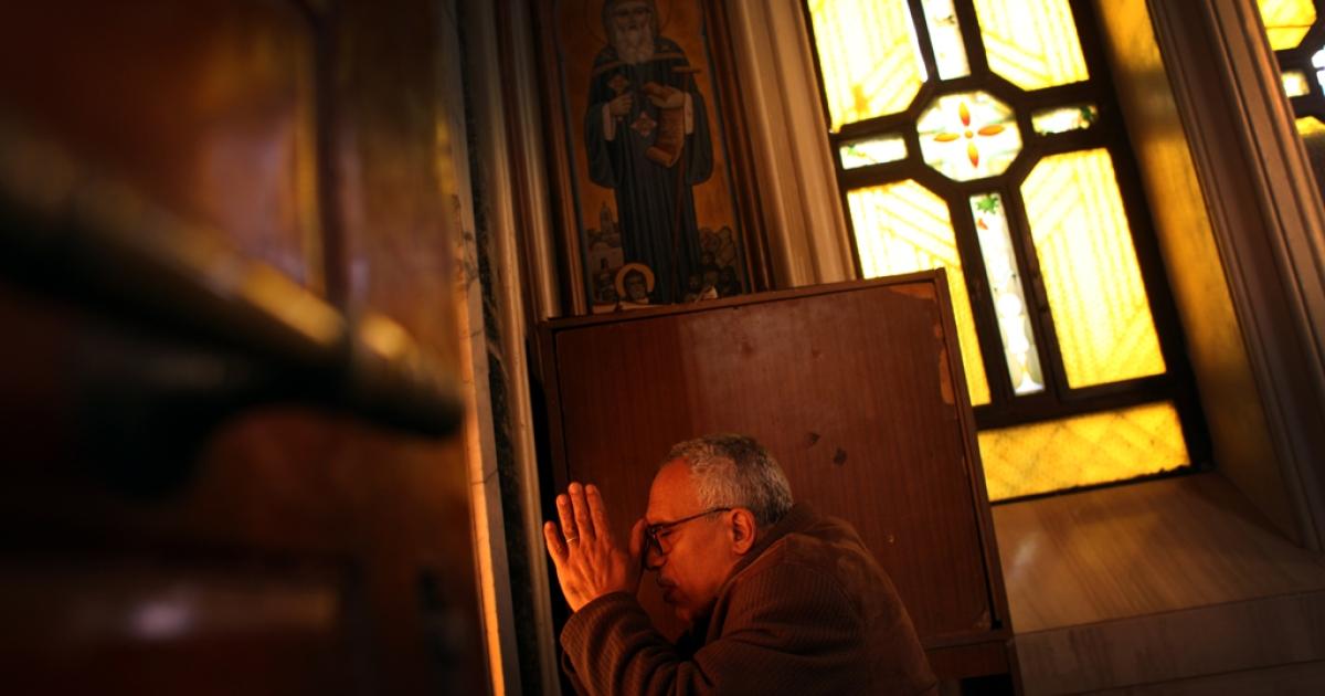 A man prays inside Cairo's Church of the Virgin Mary in the neighborhood of Shubra on Sunday Feb. 3, 2013.</p>