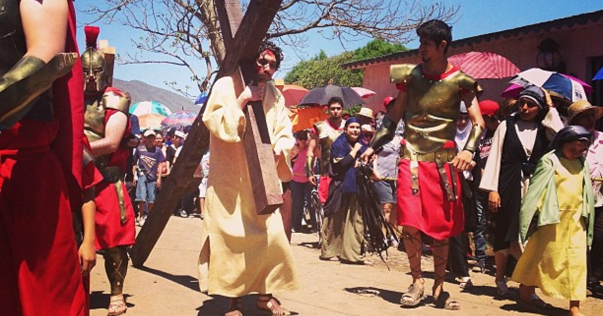 A Good Friday In Autlan, Mexico. A theatrical Jesus carries the cross through the town on his way to be crucified.</p>