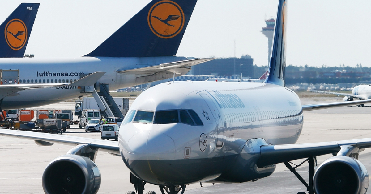 Lufthansa airplanes sit on the tarmac at the Frankfurt Rhein-Main Airport on Sep. 7, 2012.</p>