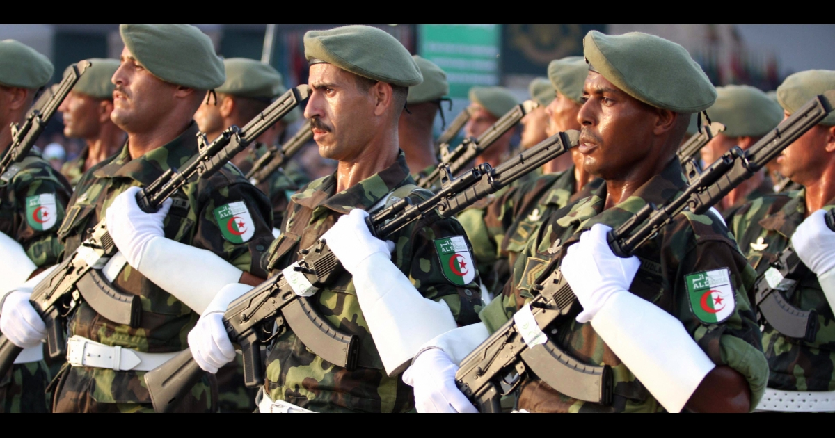 Algerian troops march during a military parade.</p>