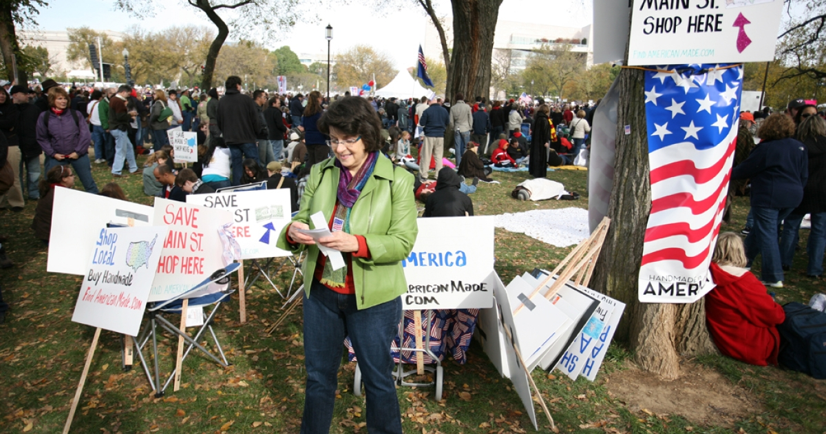 Sue Fleischer, of Casual-Elegance.com, carries out a campaign to support American made products during the Rally to Restore Sanity near the US Capitol Building on Oct. 30, 2010, in Washington, DC.</p>