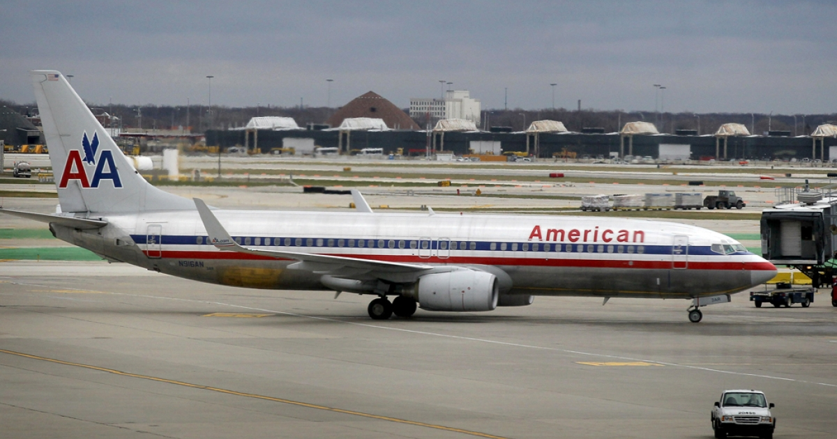 An American Airlines jet taxis to a gate at O'Hare International Airport on Nov. 29, 2011, in Chicago, Ill. On Tuesday American launched a real-time, interactive Award Map tool that shows available destinations based on the amount of frequent flier miles required for a seat.</p>