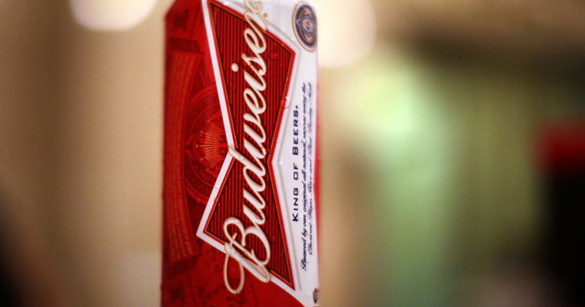 A can of Budweiser beer is displayed at a kiosk in Grand Central Terminal on Feb. 27, 2013, in New York City. A series of class action lawsuits brought against Anheuser-Busch InBev have accused the company of watering down its Budweiser, Michelob and other products.</p>