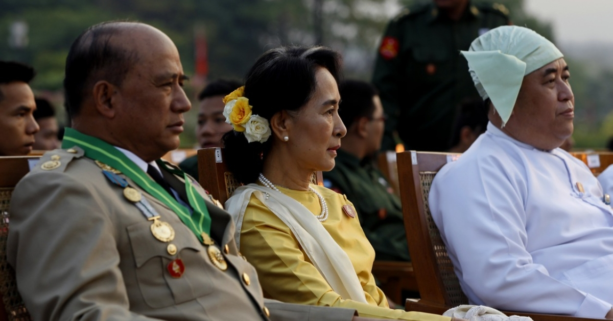 Aung San Suu Kyi, along with Major General Zaw Win (L), Deputy Minister for Border Affairs, attends a ceremony marking Myanmar's 68th Armed Forces Day at a parade ground in Naypyidaw on March 27, 2013. Suu Kyi attended Myanmar's Armed Forces Day for the first time.</p>