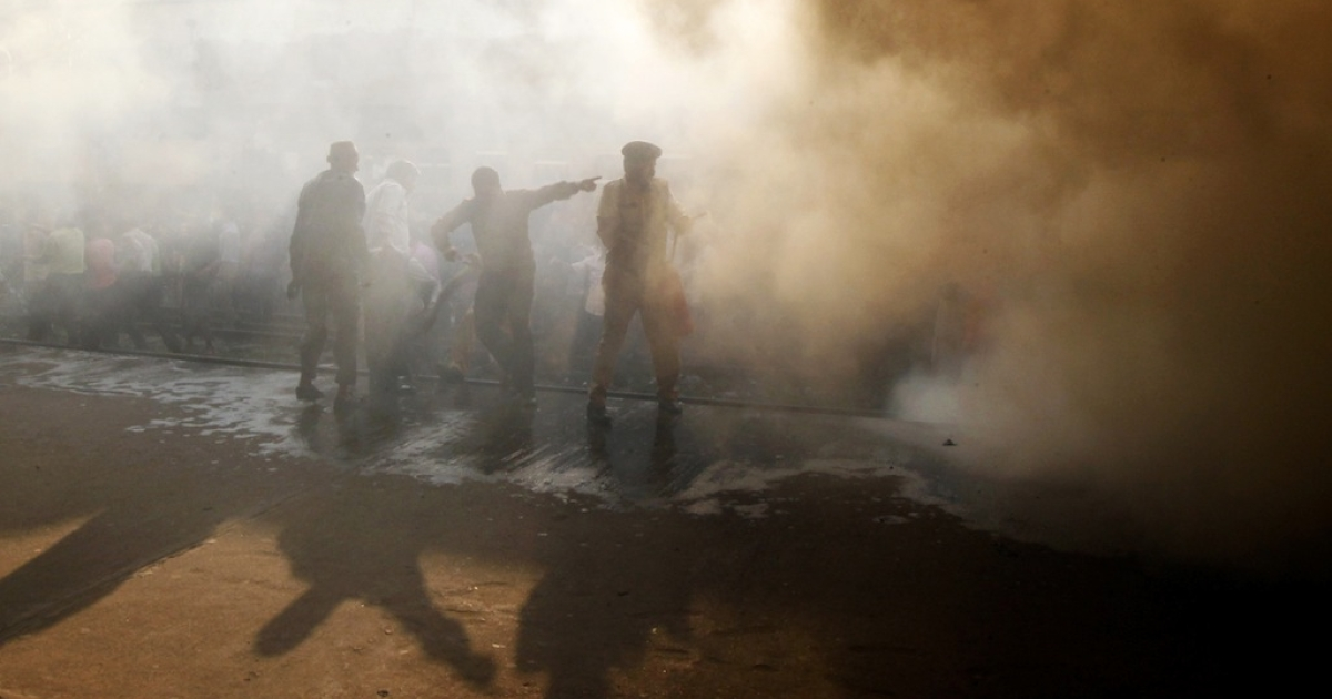 Bangladeshi firefighters attempt to extinguish a burning train compartment at the Kamalapur Railway Station during a nationwide strike called by Jamaat-e-Islami in Dhaka on March 4, 2013.</p>