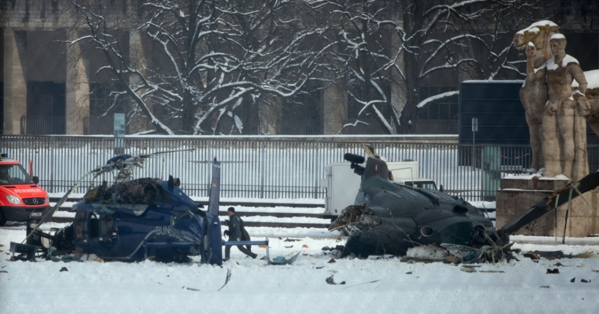 A police officer works at the scene where two police helicopters crashed near the Olympic stadium in Berlin on March 21, 2103. The helicopters crashed as they were landing after a training exercise.</p>