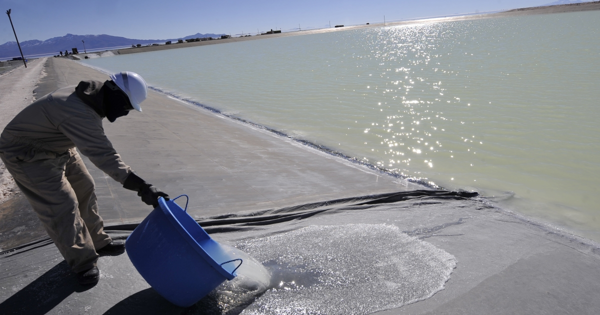 An employee works at the brine pool at Uyuni.</p>