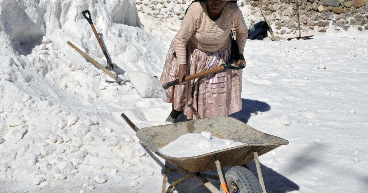 An Aymara indigenous woman collects salt in the world's largest salt flat in Bolivia.</p>