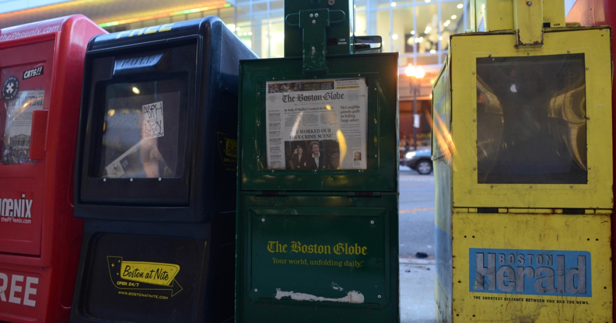 A newspaper box offers copies of The Boston Globe, The Boston Herald and The Boston Phoenix. The Boston Phoenix announced that it would be stopping publication immediately on March 14, 2013.</p>