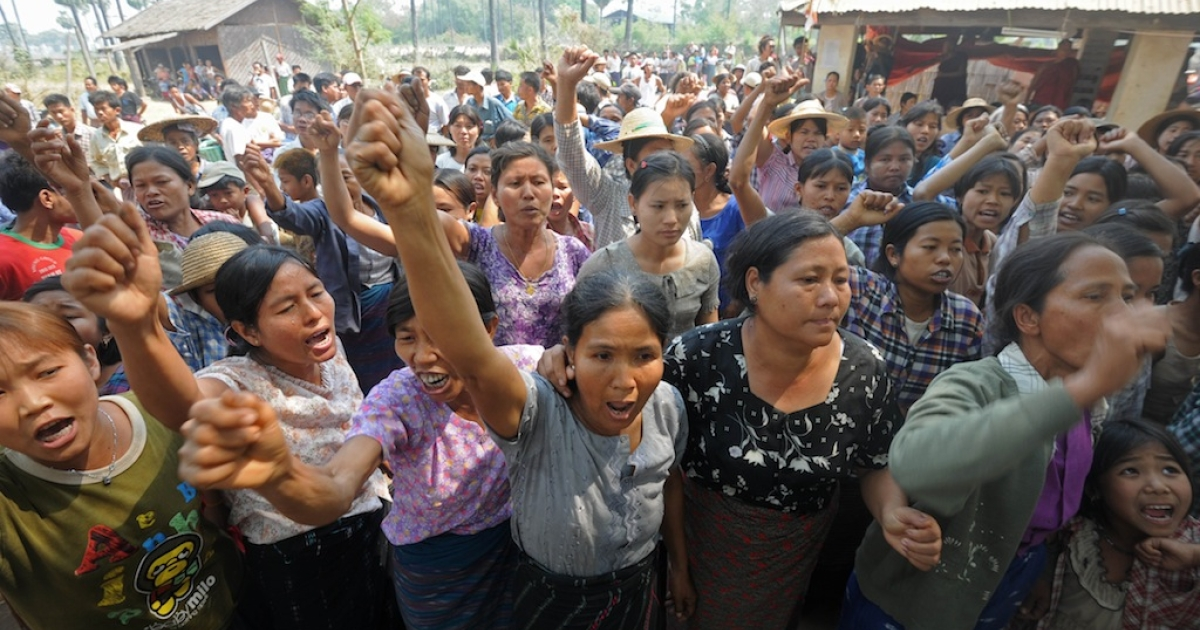 Villagers shout slogans as they protest against Myanmar opposition leader Aung San Suu Kyi's stand on a Chinese-backed copper mine project. Suu Kyi urged protesters to accept a controversial Chinese-backed mine that was the scene of a violent crackdown last year, or risk hurting the economy.</p>