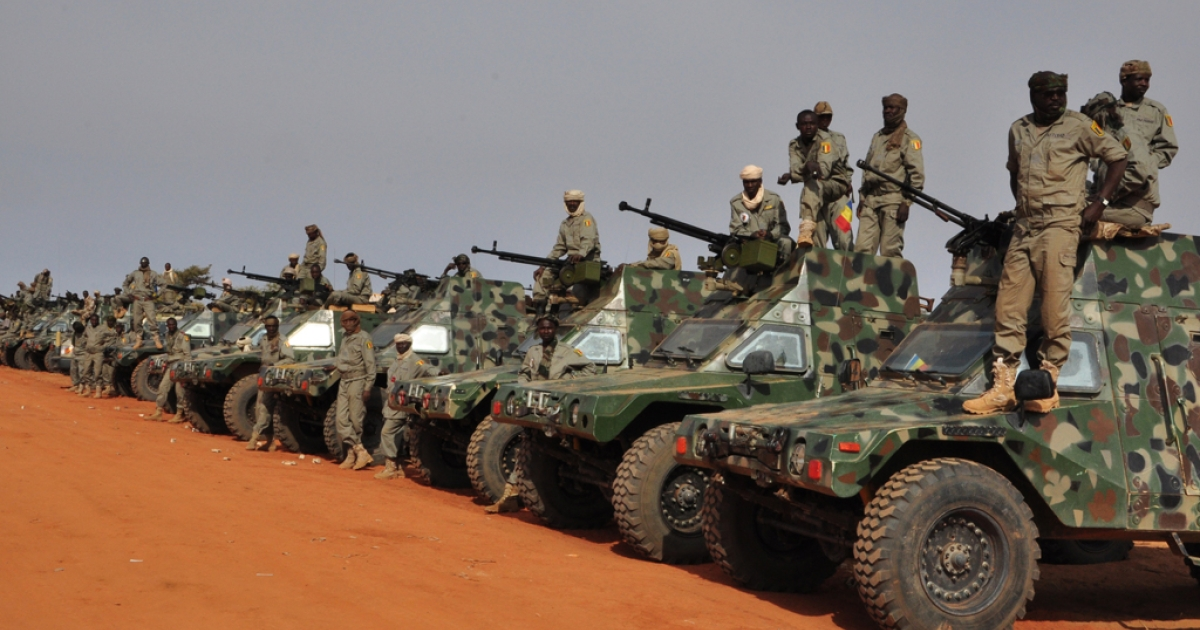 Chadian soldiers stand in front of their armoured vehicles as they prepare to leave a military camp on the outskirts of Niamey on January 24, 2013, on their way to Mali. Chad's president said on March 1, 2013, that it was Chadian soldiers who killed Al Qaeda in the Islamic Maghreb's leader Abu Zeid.</p>
