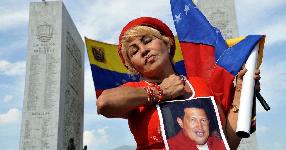A Venezuelan Chavista waits to bid farewell to Hugo Chavez.</p>