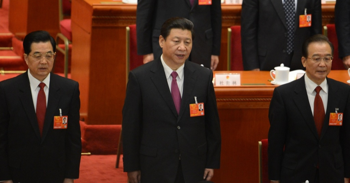 Former Chinese president Hu Jintao, newly-elected Chinese President Xi Jinping and former premier Wen Jiabao sing the national anthem at the closing session of the National People's Congress (NPC) at the Great Hall of the People in Beijing on March 17, 2013. Xi said he would fight for a 'great renaissance of the Chinese nation', in his first speech as head of state of the world's most populous country.</p>