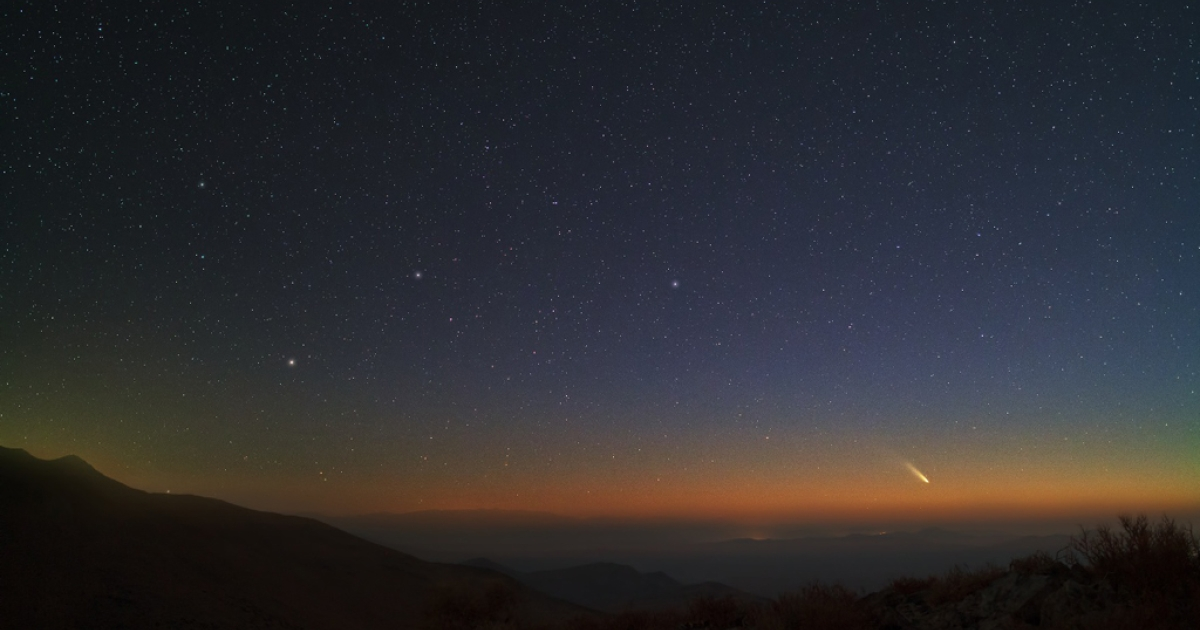 Two impressive comets will both reach their peak brightness during the next two weeks. Comet C/2011 L4 (PanSTARRS), visible near the horizon on the lower right, is showing a bright tail dominated by dust reflecting sunlight.</p>