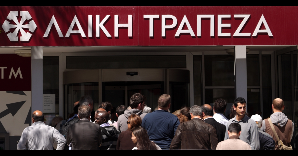 Cypriots line up outside a Laiki bank branch in Cyprus' capital, Nicosia, on March 28, when banks opened after a 12-day lockdown.</p>