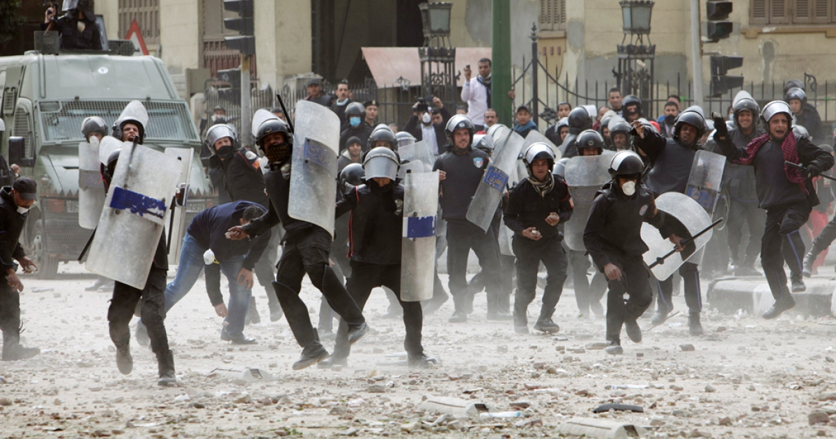 Egyptian riot police charge towards protesters near Egypt's Interior Ministry, as violent demonstrations continued into their second day on Feb. 3, 2012 in central Cairo, Egypt. As the country's turmoil continues and huge swaths of the police force strike to protest their working conditions, the government is exploring private security companies as possible replacements.</p>