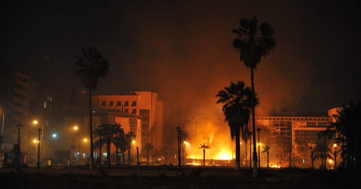 Flames light the sky as Egyptians protesters clash with security forces in Port Said late on March 3, 2013. Four people including two policemen were killed in overnight clashes between security forces and protesters in Egypt's restive canal city of Port Said, the interior ministry said on March 4, 2013.</p>