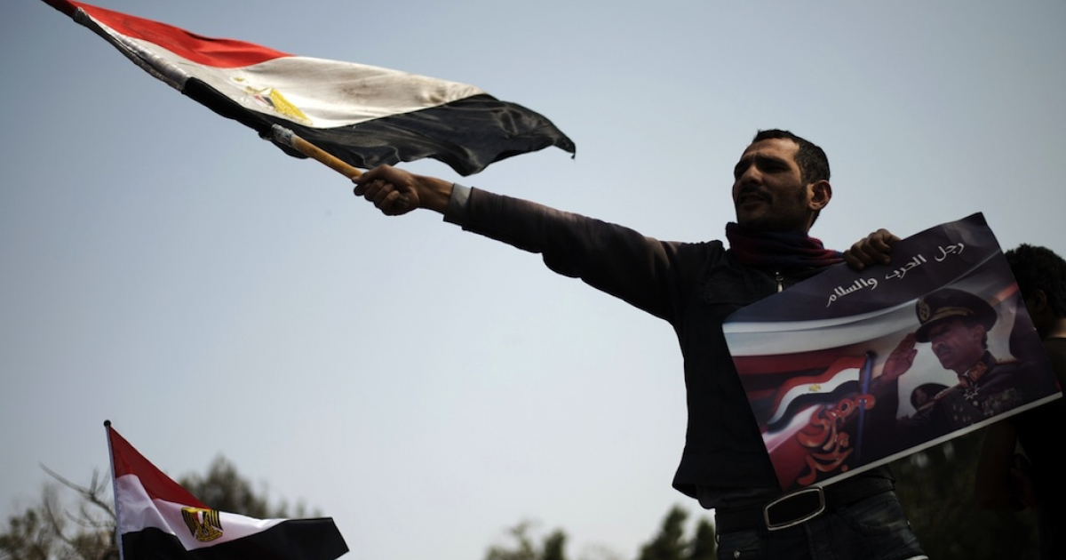 Almost every Friday opposition groups protest against President Mohamed Morsi. Here an Egyptian protester waves his national flag in Cairo on March 1, 2013.</p>