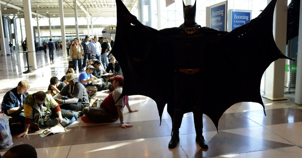 A man dressed as Batman waits with other fans during the opening session of the 2012 New York Comic Con at the Jacob Javits Center October 11, 2012. A man dressed as Batman delivered a criminal to police in Bradford, England on Feb 25, 2013.</p>