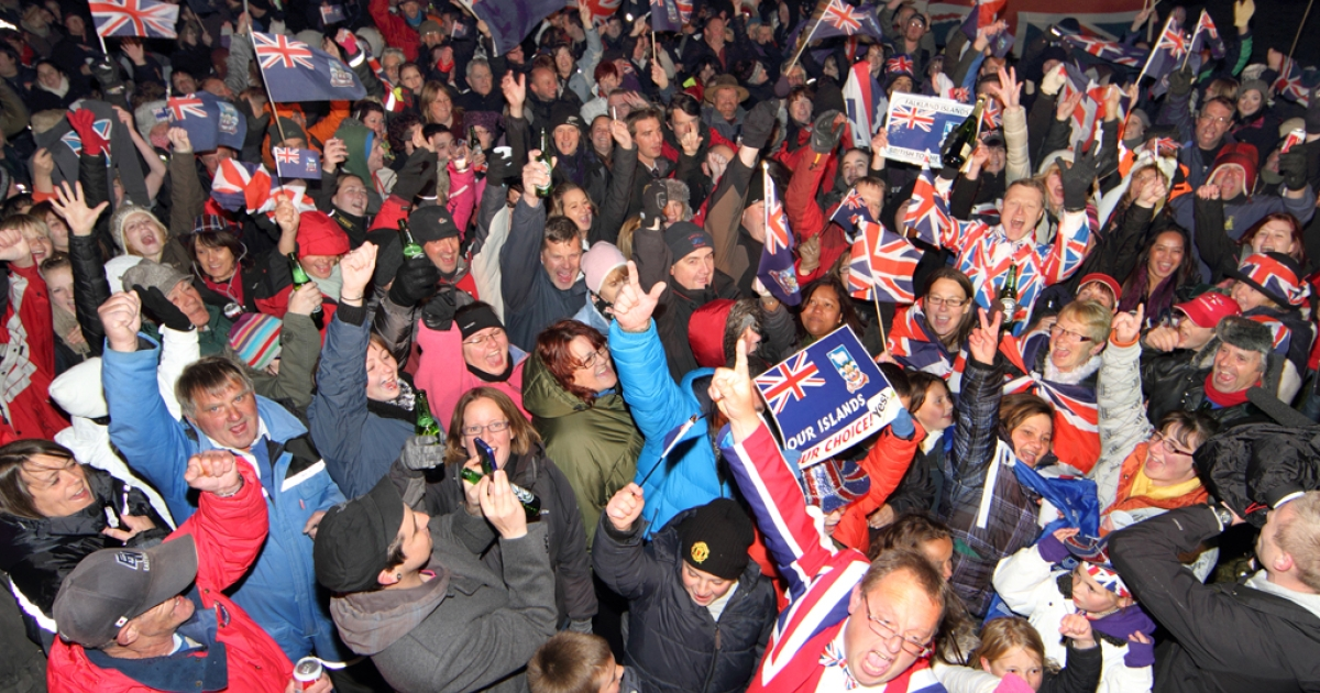 Residents of the Falkland Islands celebrate in the capital city of Port Stanley after the announcement of the referendum's results on March 11, 2013. Almost all of the islanders voted to remain a British Overseas Territory, with three lone voices voting in favor of Argentina.</p>