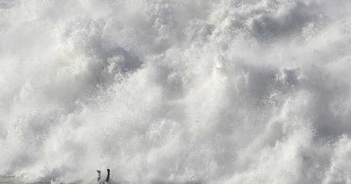 A surfer falls while taking part in the Arnette Punta Galea Big Wave World Tour on Jan. 28, 2013, in the Northern Spanish Basque town of Getxo.</p>
