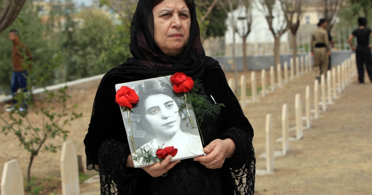 An Iraqi Kurdish woman visits the grave of her sister, who was killed in a gas attack by former Iraqi president Saddam Hussein in 1988, during the 25th anniversary of the attack at the memorial site of the victims in the Kurdish town of Halabja, 300 kms (190 miles) northeast of Baghdad, on March 16, 2013. Many of those paying their respects held pictures of some of the estimated 5,000 people who were killed, most women and children, in what is now thought to have been the worst ever gas attack against civilians.</p>