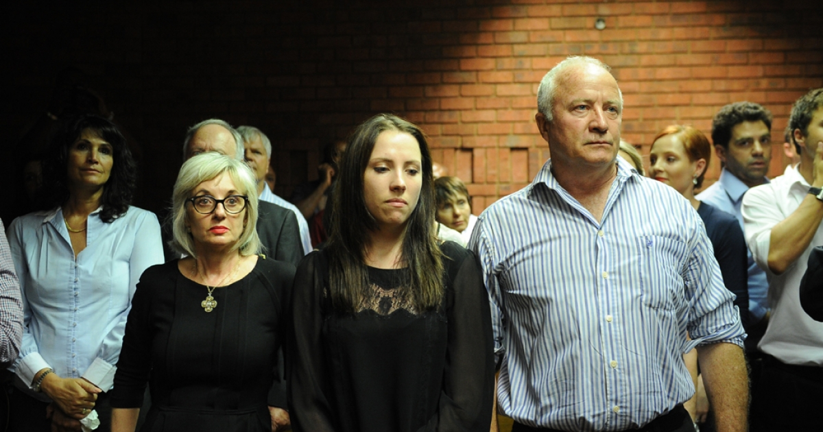 The father of South African Olympic sprinter Oscar Pistorius, Henke (R) and his sister Aimee (C) attend  an audience of Oscar Pistorius' bail hearing  for premeditated murder of his girlfriend at the courthouse in Pretoria on Feb. 22, 2013.</p>