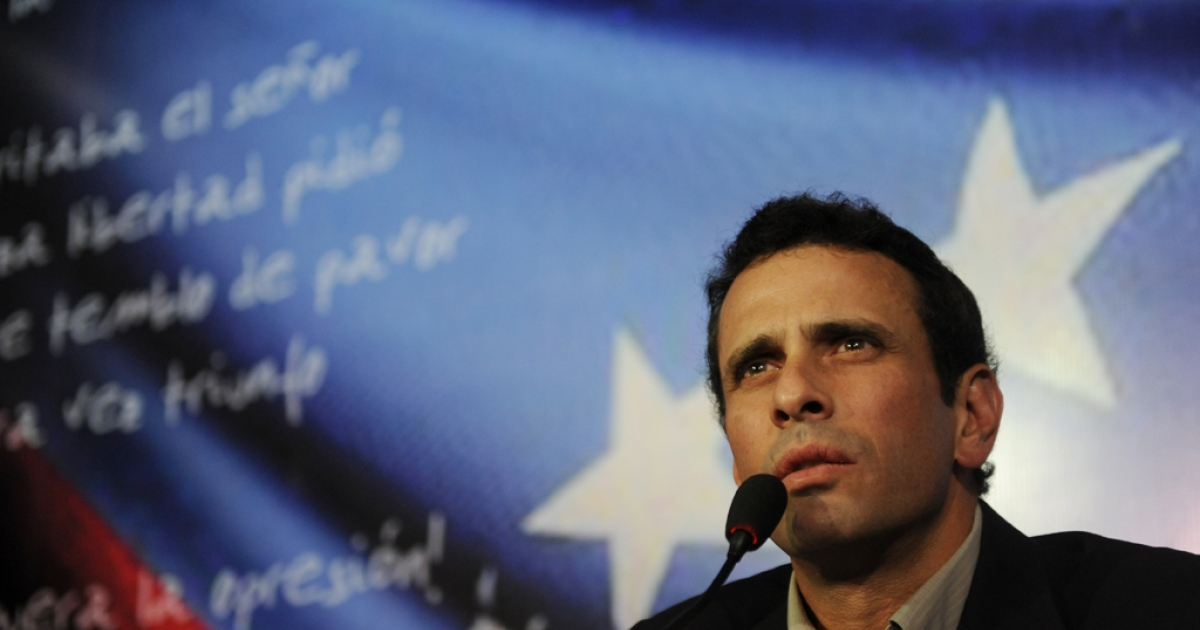 Venezuelan opposition leader Henrique Capriles speaks at a press conference in Caracas on March 10, 2013. Capriles announced Sunday that he will run in the April 14 presidential election against interim President Nicolas Maduro.</p>