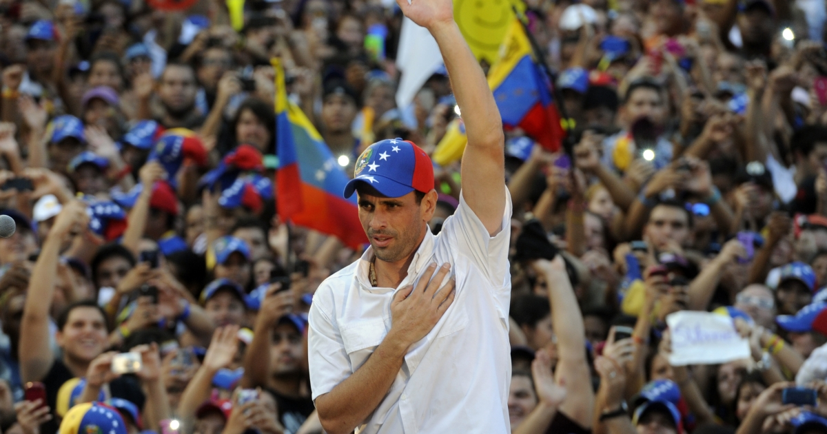 Venezuelan presidential candidate, Henrique Capriles, gestures during a campaign rally in Naguanagua, Carabobo state, Venezuela, on March 21, 2013.</p>