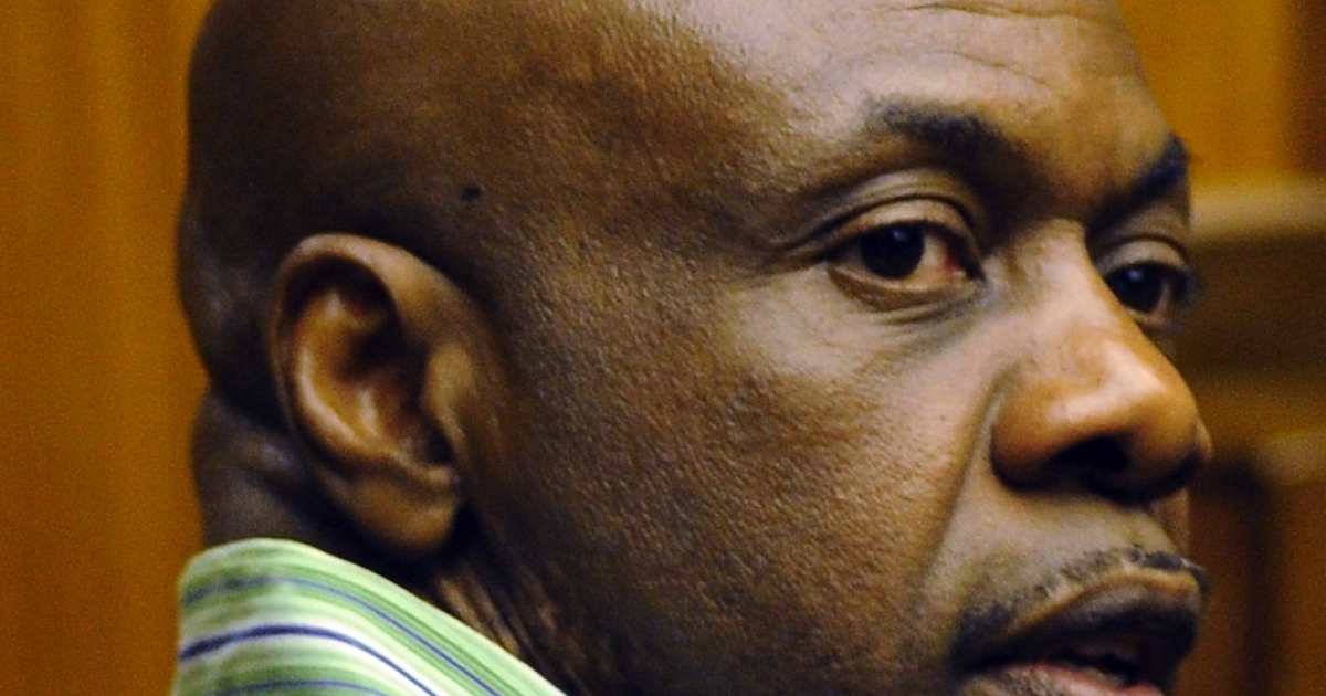 Nigerian militant leader Henry Okah is pictured at Johannesburg High Court on February 28, 2013. A South African court on March 26, 2013 jailed Nigerian national Henry Okah for 24 years in prison after he was convicted of 13 terrorism charges related to the 2010 independence day bombings.</p>