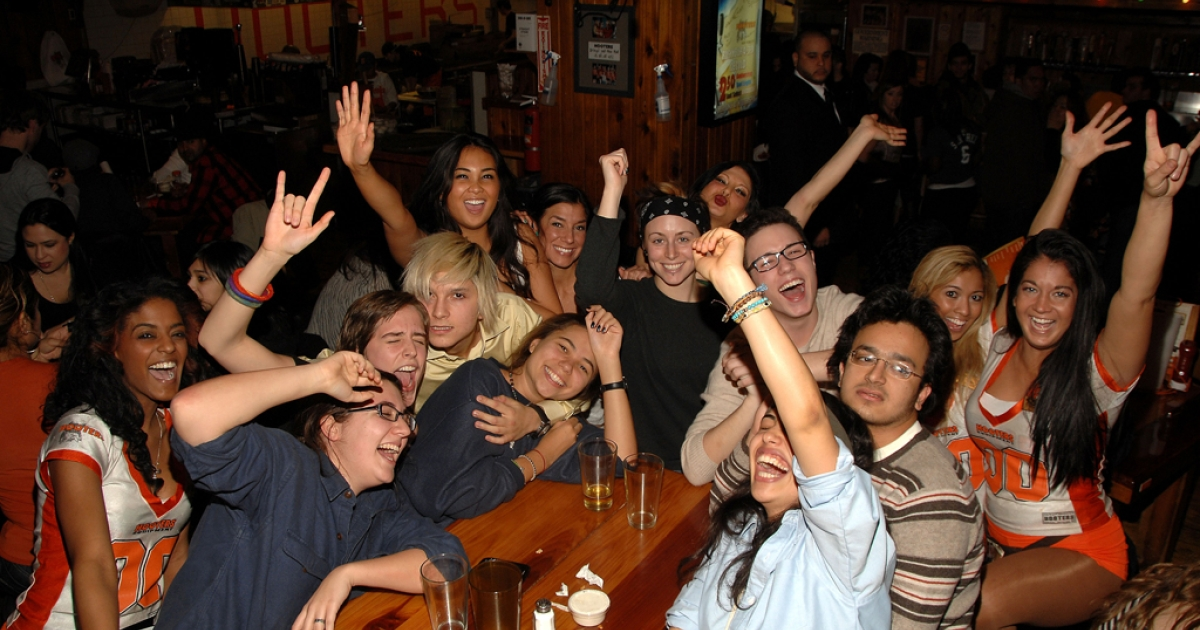This photo shows the atmosphere at Hooters during the broadcast of Super Bowl XLV on Feb. 6, 2011, in New York City. Middling sales have forced the restaurant chain to consider overhauling its brand in favor of drawing new customer bases.</p>