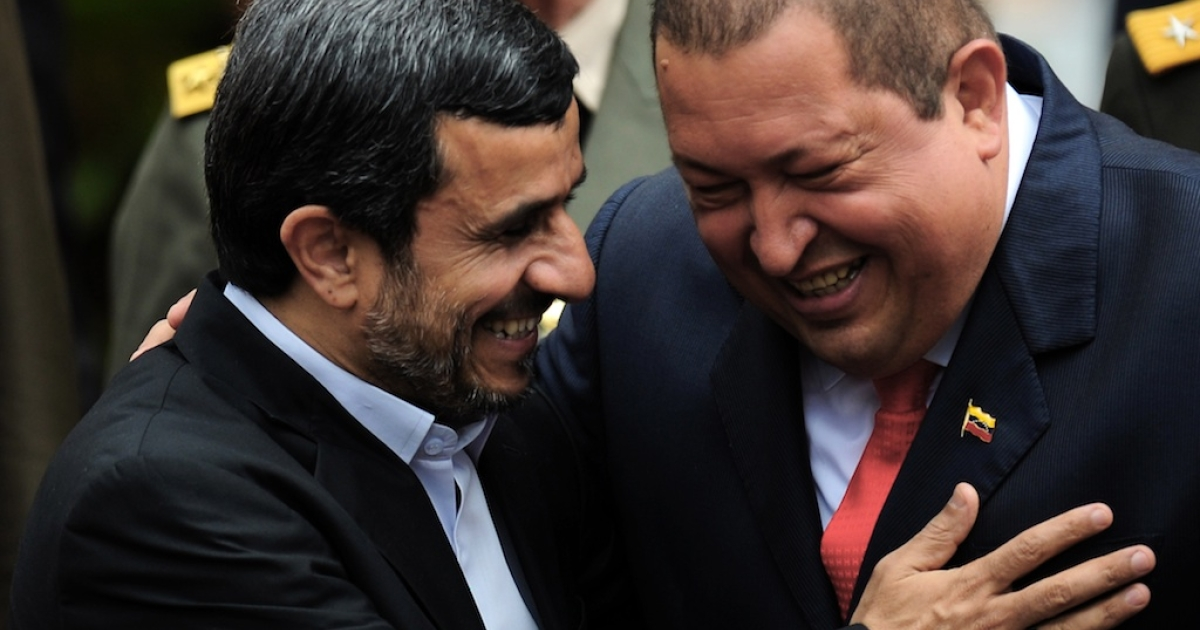 Venezuelan President Hugo Chavez (R) and his Iranian counterpart Mahmoud Ahmadinejad (L), smile at Miraflores presidential palace in Caracas on January 9, 2012. President Hugo Chavez passed away on March 5, 2013 in Caracas after a long fight with cancer.</p>