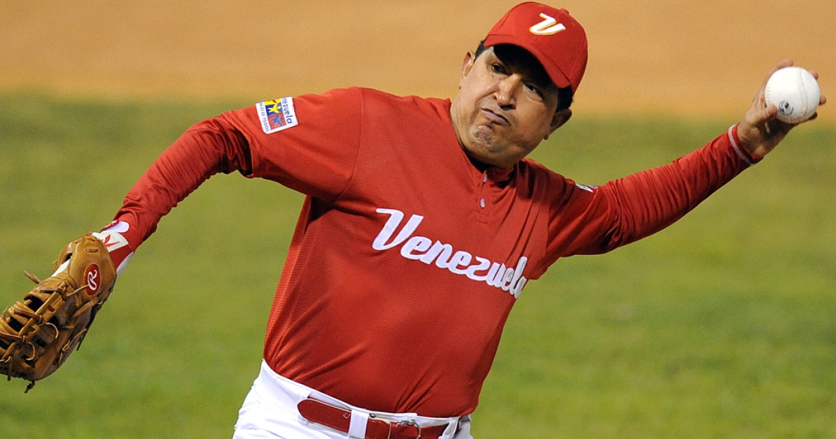 Venezuelan President Hugo Chavez prepares to toss a ball before a softball match with professional Venezuelan players in Caracas on February 11, 2010. Chavez died on March 5, 2013, at age 58 after a year long battle with cancer.</p>