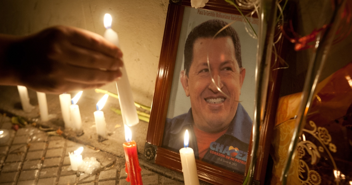Supporters of Venezuelan President Hugo Chavez light candles in front of the Venezuelan Embassy in Santiago, Chile.</p>