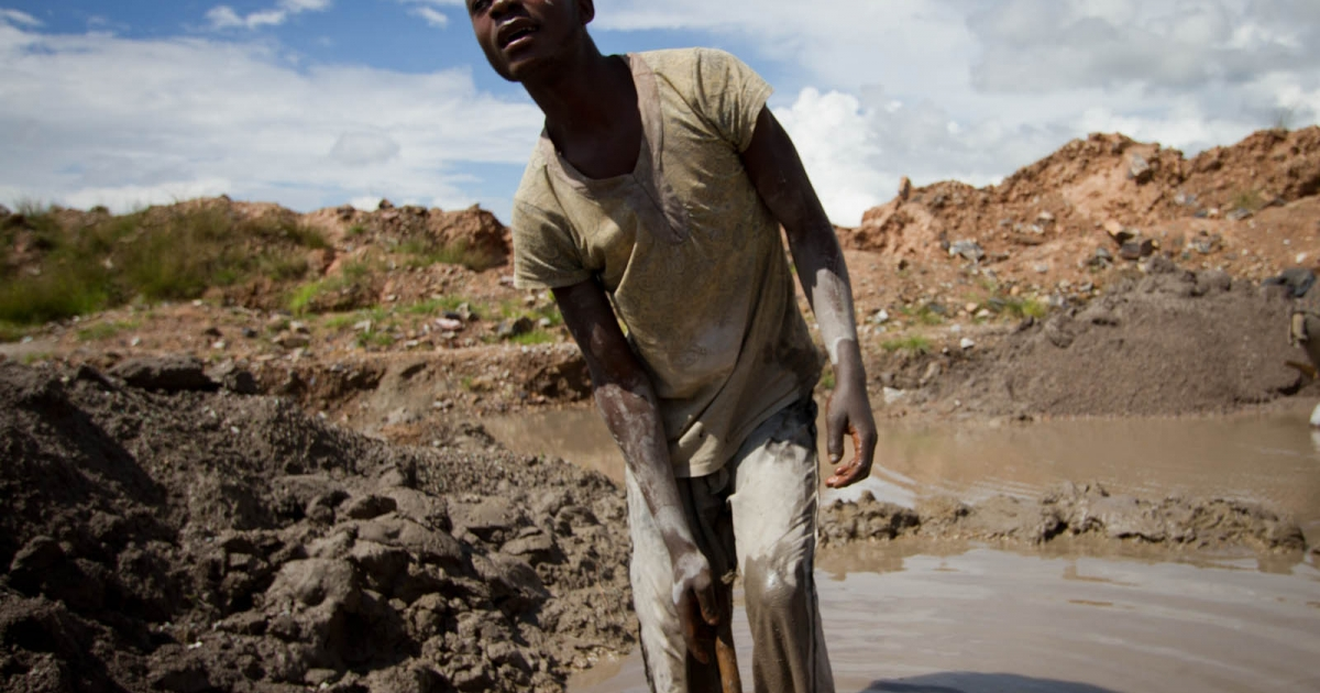 A man digs in muddy water for copper ore as part of an artisanal mining operation in Kolwezi, Congo.</p>
