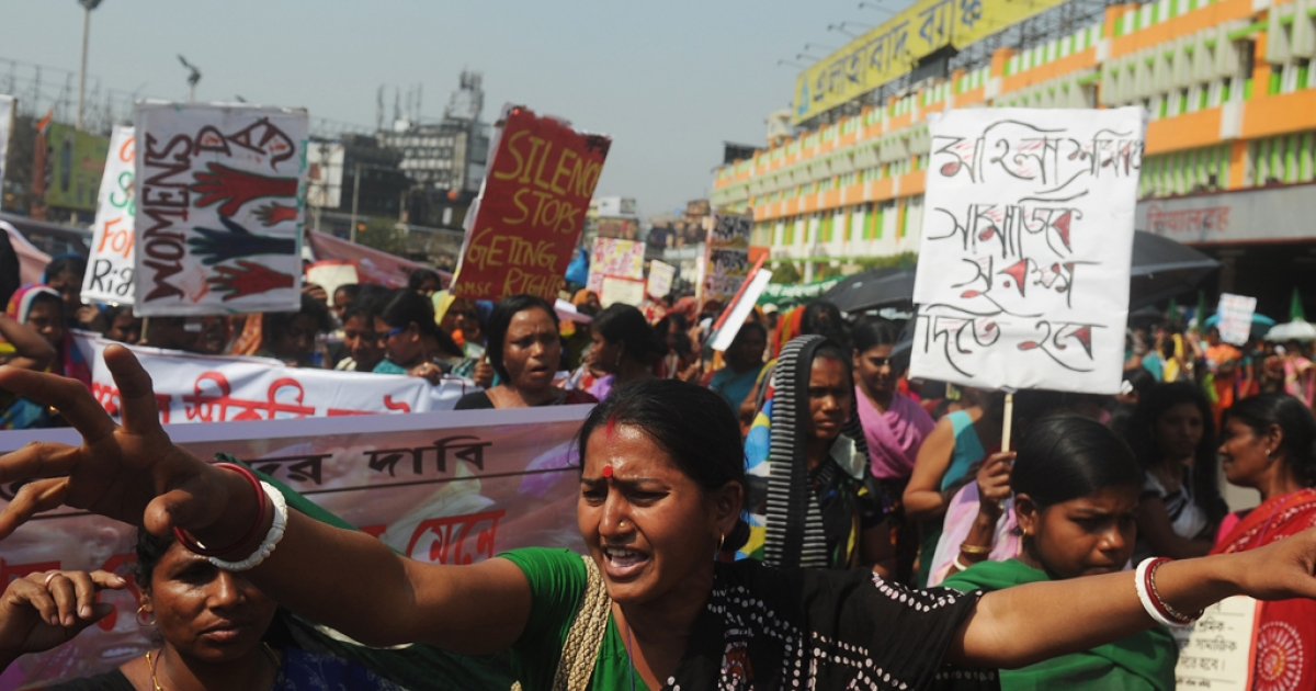 Indian female laborers and sex workers participate in a rally on International World Women's day in Kolkata on March 8, 2013. Elsewhere, in the state of Odisha, women stripped in protest of a land acquisition deal.</p>