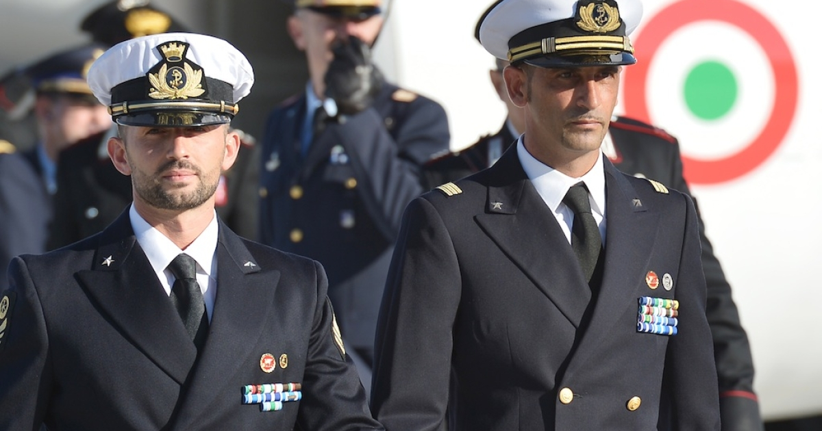 This picture taken on Dec. 22 shows Salvatore Girone, left, and Massimiliano Latorre arriving at Ciampino airport near Rome.</p>