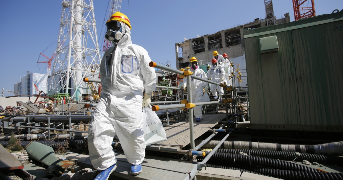 Visitors and workers are required to wear protective suits and masks at Japan's Fukushima nuclear power plant, which was rocked by the March 11, 2011 tsunami and earthquake.</p>