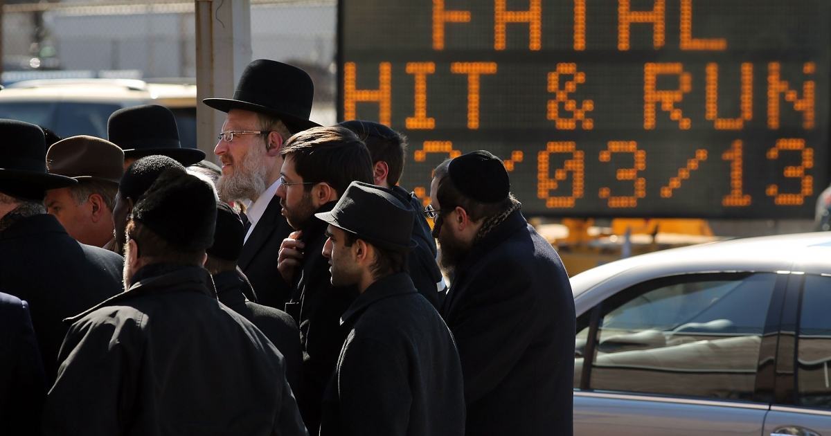 Members of the Brooklyn Orthodox community attend a news conference to discuss the recent deaths of a Orthodox couple and their unborn child, killed in a hit and run crash in Brooklyn on March 4, 2013 in New York City.</p>