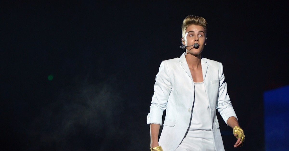 Justin Bieber performs during a concert at the Palais Omnisport de Paris-Bercy on March 19, 2013.</p>