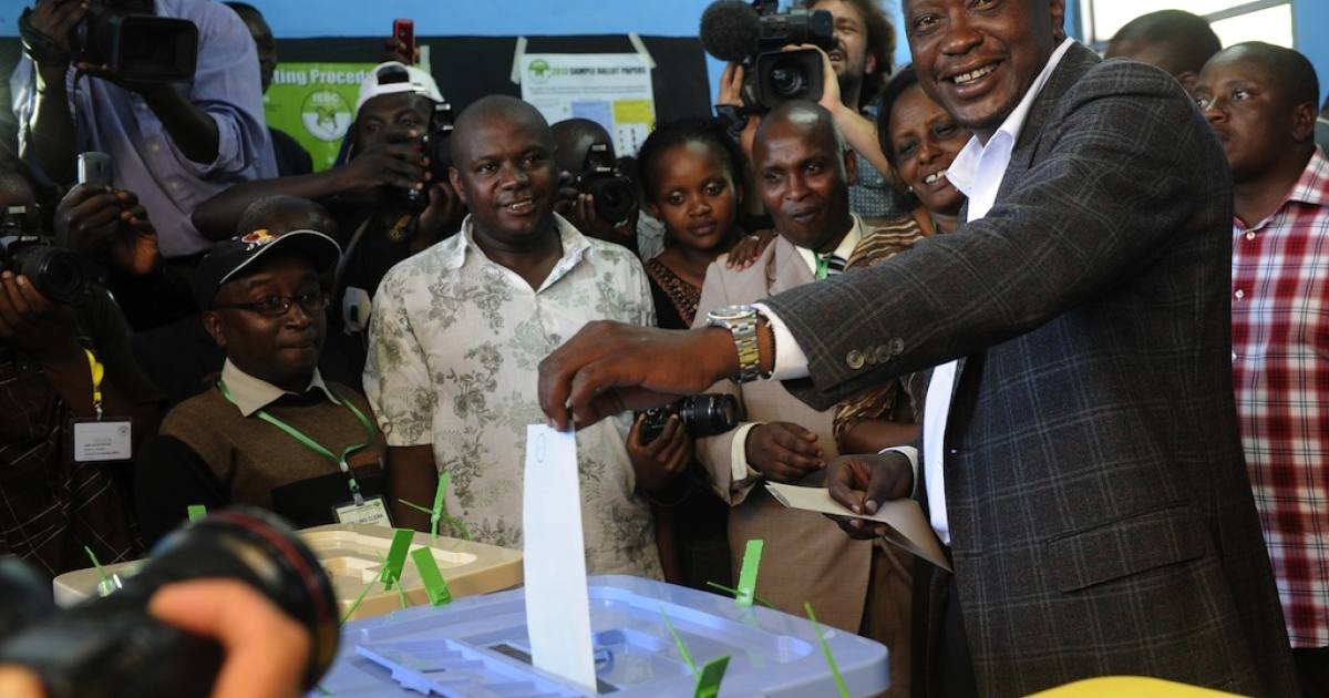 Kenya's Deputy Prime Minister and presidential candidate Uhuru Kenyatta casts his vote at the Mutomo primary school in Kiambu on March 4, 2013.</p>