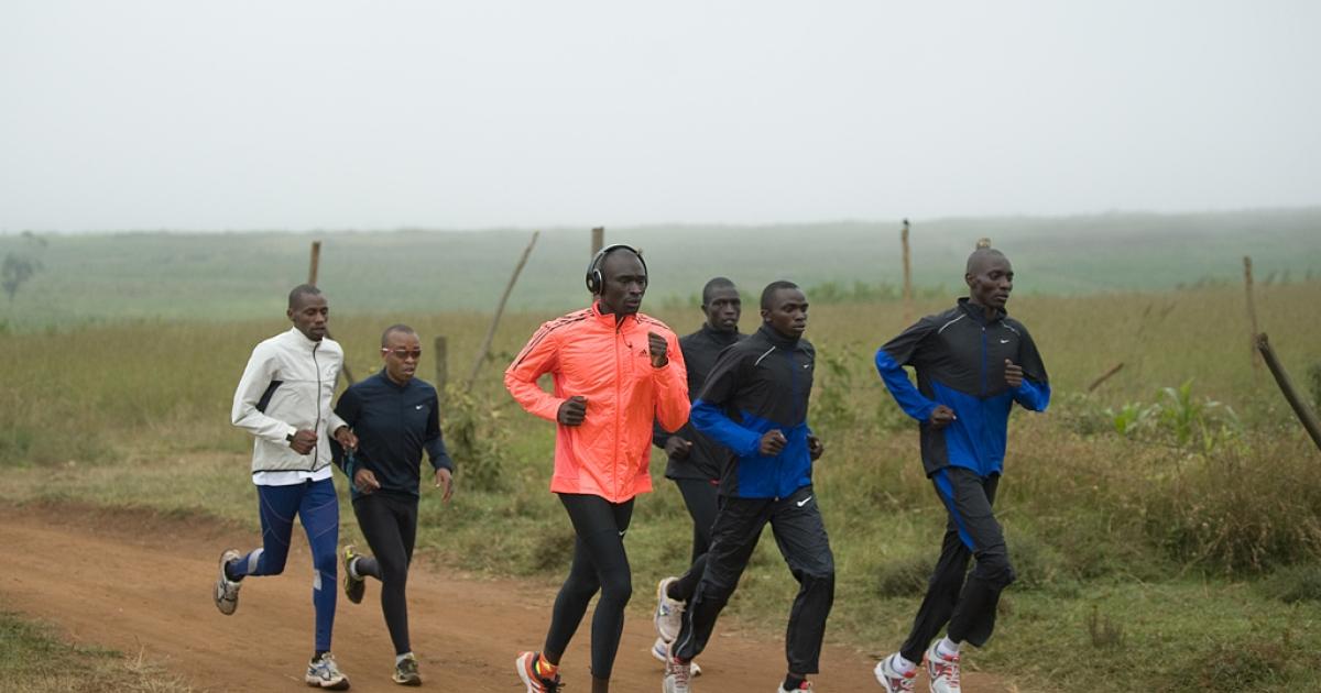 David Rudisha (in orange), the 800-meter world record holder, runs during a morning workout near Nairobi, Kenya, on July 25, 2012.</p>