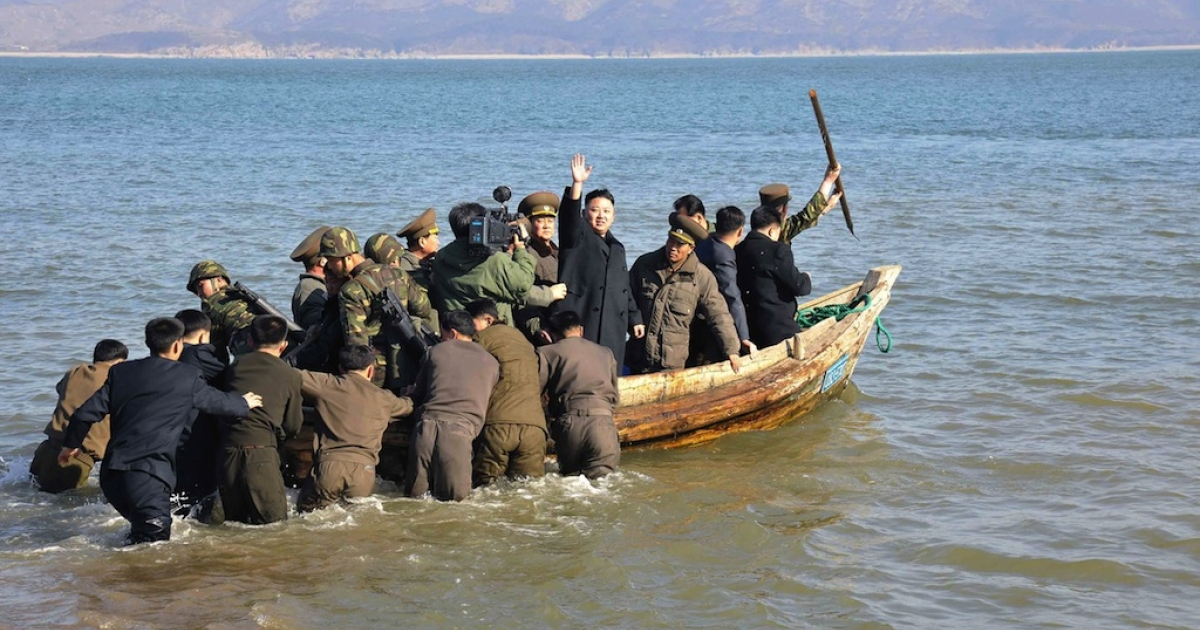 This undated picture taken by North Korea's official Korean Central News Agency on March 11, 2013 shows North Korean leader Kim Jong Un (C) leaving the Wolnae Islet Defence Detachment after inspection in North Korea's western sector near the disputed maritime frontier with South Korea.</p>