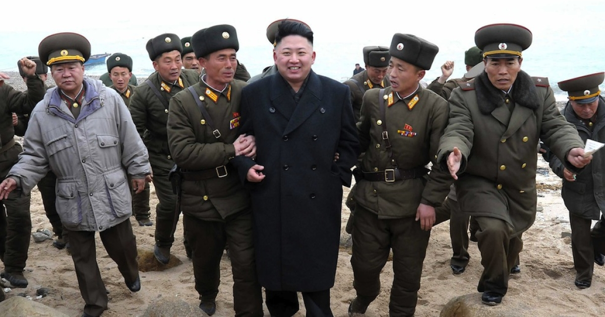 North Korean leader Kim Jong Un (C) is greeted by soldiers as he inspects the Mu Islet Hero Defence Detachment on March 7, 2013.</p>