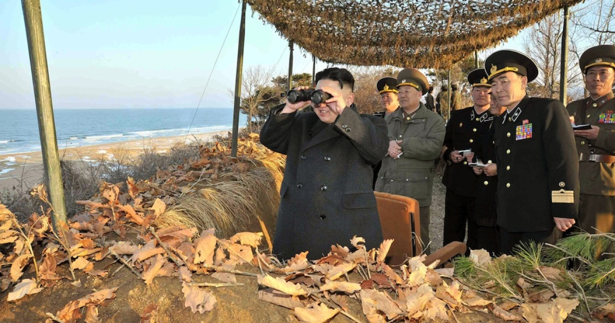 Kim Jong Un inspects the landing and anti-landing drills of KPA Large Combined Units 324 and 287 and KPA Navy Combined Unit 597 at an undisclosed location on North Korea's east coast on March 25, 2013.</p>