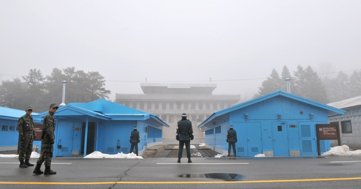 South Korean soldiers stand guard in fog at the truce village of Panmunjom in the demilitarized zone dividing North and South Korea on February 27, 2013. North Korea has threatened to cancel the truce between the two countries that ended their 1950-53 war.</p>