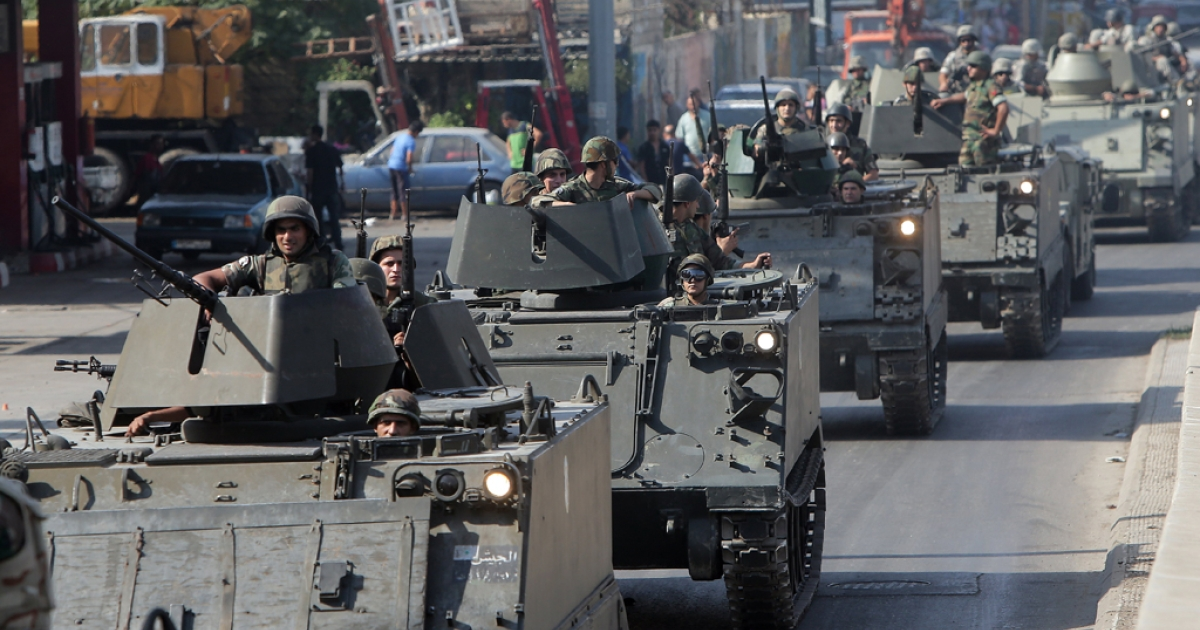 Lebanese army tanks are deployed in the Bab al-Tabbaneh and Jabal Mohsen neighborhoods in the coastal city of Tripoli, Lebanon, on Oct. 23, 2013. Tripoli is Lebanon's second largest city, home to roughly 500,000 people, but it frequently serves as a proxy battleground between supporters and opponents of Syrian President Bashar al-Assad.</p>