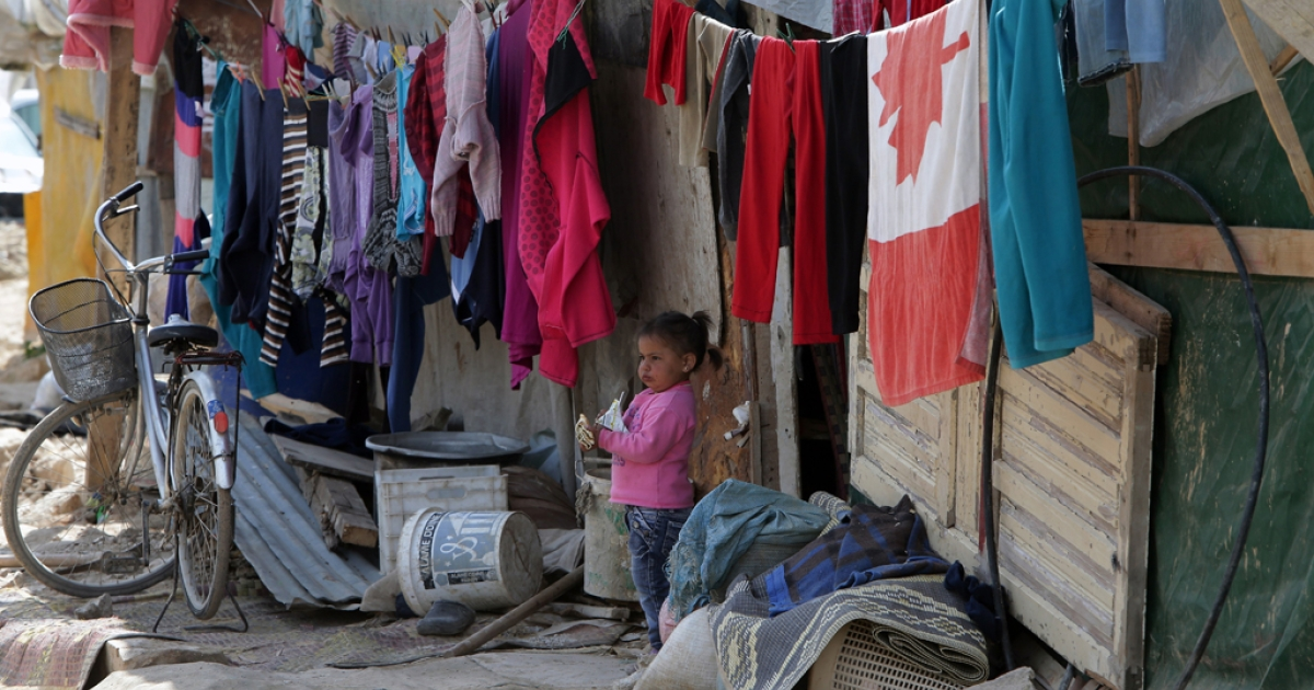 A Syrian refugee child stands outside the shanty rented by her parents in a poor neighborhood of the northern Lebanese city of Tripoli on March 7, 2013. A significant number of Syrians have fled their country since deadly civil strife erupted just over two years ago, but now the focus has turned to financial aid as some of the refugee programs struggle to deal with the growing number of those displaced by the conflict.</p>